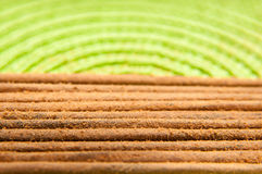 Incentive sticks. On a green fabric in close up mode royalty free stock photography