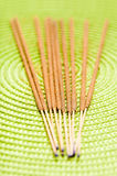 Incentive sticks. On a green fabric in close up mode stock images