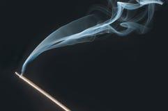 Incentive sticks. Smoke on black stock photo