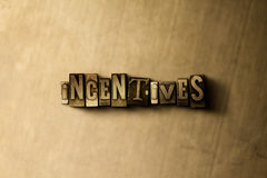INCENTIVES - close-up of grungy vintage typeset word on metal backdrop Royalty Free Stock Photos