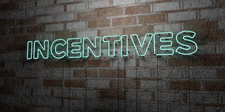 INCENTIVES - Glowing Neon Sign on stonework wall - 3D rendered royalty free stock illustration Stock Photos
