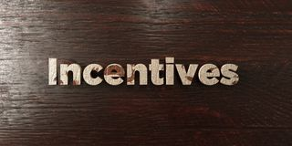 Incentives - grungy wooden headline on Maple  - 3D rendered royalty free stock image Royalty Free Stock Photo