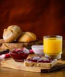 Inceppamento e succo d'arancia di frutta Immagine Stock
