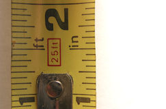 About an Inch. Close up Photo of a Tape Measurer Stock Image