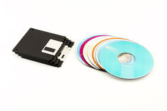 1.44 inch Floppy disks and CD / DVD discs lie on a white backgro Royalty Free Stock Photography