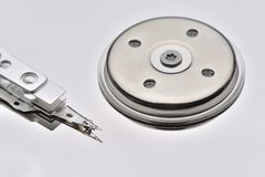 2.5 inch opened hard disk drive with reading head.  Royalty Free Stock Photos