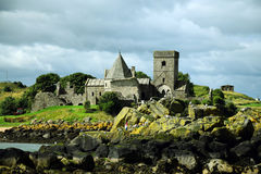 Inchcolm Abbey. Is a medieval abbey located on the island of Inchcolm in the Firth of Forth in Scotland. The Abbey, which is located at the centre of the island stock photography