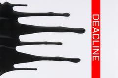 Inching Towards Deadline. Black ink slowly trailing towards a red marking labeled 'DEADLINE'. Horizontal shot royalty free stock photos
