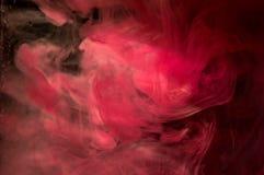 Inchiostro arancio rosso in acqua Illuminazione del sole Movimento dinamico di Immagine Stock