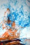 Inchiostro fumoso rosso e blu   Immagini Stock Libere da Diritti