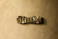 INCIDENCE - close-up of grungy vintage typeset word on metal backdrop Royalty Free Stock Photo