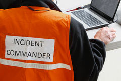 Incident Commander. An Incident Commander is in charge at any natural or manmade disaster or major accident. Telecommunications is very important to keep on top Royalty Free Stock Photos