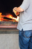 Incineration of gold papers for blessing Stock Photography