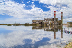 Incinerator with chimneys close to a lagoon stock photo