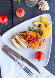 Incision baked chicken in a spicy curry sauce with vegetables Stock Photography