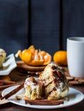 Incision buns Cinnabon cinnamon, nuts and cream sauce Royalty Free Stock Image