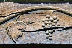 Incisione del legno originale dell'uva e della vite Immagini Stock