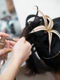 Incitando sera donna a coiffure fotografie stock