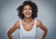 Inclinação fêmea de riso para a frente fotos de stock royalty free