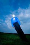 Inclinação sem cara do homem Fotografia de Stock Royalty Free