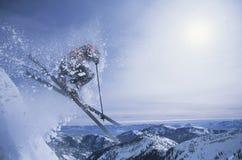 Inclinação de Person On Skis Jumping Over Foto de Stock Royalty Free