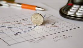 Inclinazione verso il basso di economia Fotografia Stock