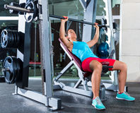 Incline Barbell Bench Press woman in multipower Royalty Free Stock Photography