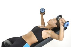 Incline Press 1. A female fitness instructor demonstrates the starting position of the incline dumbbell press Stock Photo