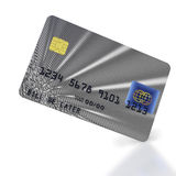Inclined silver credit card. Silver inclined credit card on white background Royalty Free Stock Photo