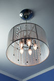 Included chandelier on the ceiling. Arming chandeliers with crystals and nitevatym shade on the ceiling stock photos