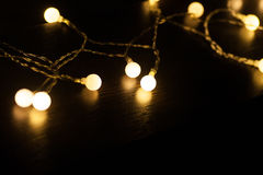 Included a garland on a dark background Royalty Free Stock Photos