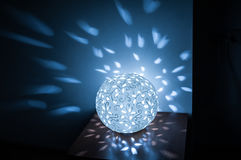 Included lamp ball on table in kitchen with blue light Royalty Free Stock Image