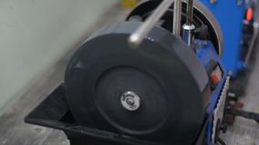 Equipment for tool sharpening. Spinning disk which will sharpen stock video