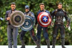 Incluindo muitas versões do capitão América imagem de stock