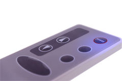 The inclusion button on a remote control. Removed on a white background Stock Photos