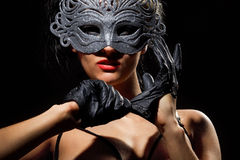 Incognito woman in ancient style mask Stock Photo