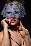 Incognito woman in ancient style mask Stock Photos
