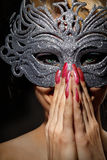 Incognito woman in ancient style mask stock photography