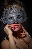 Incognito woman in ancient style mask Royalty Free Stock Photography