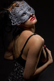 Incognito woman in ancient style mask Stock Image