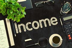 Income Concept on Black Chalkboard. 3D Rendering. Black Chalkboard with Income. 3d Rendering. Toned Illustration Royalty Free Stock Photos