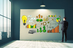 Income concept. Businessman drawing colorful business sketch on billboard in empty interior with city view and daylight. Income concept. 3D Rendering Stock Image