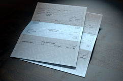 Income Inequality Paychecks. A 3D render concept showing two fictitious paychecks with a huge difference in the nett pay highlighting the income inequality Royalty Free Stock Image