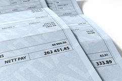 Income Inequality Paychecks. A 3D render concept showing two fictitious paychecks with a huge difference in the nett pay highlighting the income inequality Stock Photography