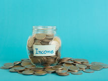 Income money jar Royalty Free Stock Photos