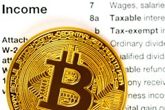 Income part of tax return 1040 form with metallic bitcoin coin royalty free stock images