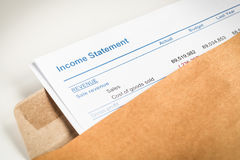 Income statement letter in brown envelope opening, business conc Stock Photo