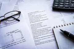 Income Statement report with calculator, document is mock-up stock photography