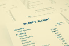 Income statement reports for business accounting in sepia tone. Income statement reports with detail list of revenues and expenses for business accounting Stock Images