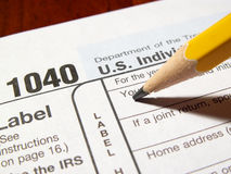 Income tax 1040 preparation. Filling out tax forms royalty free stock photography